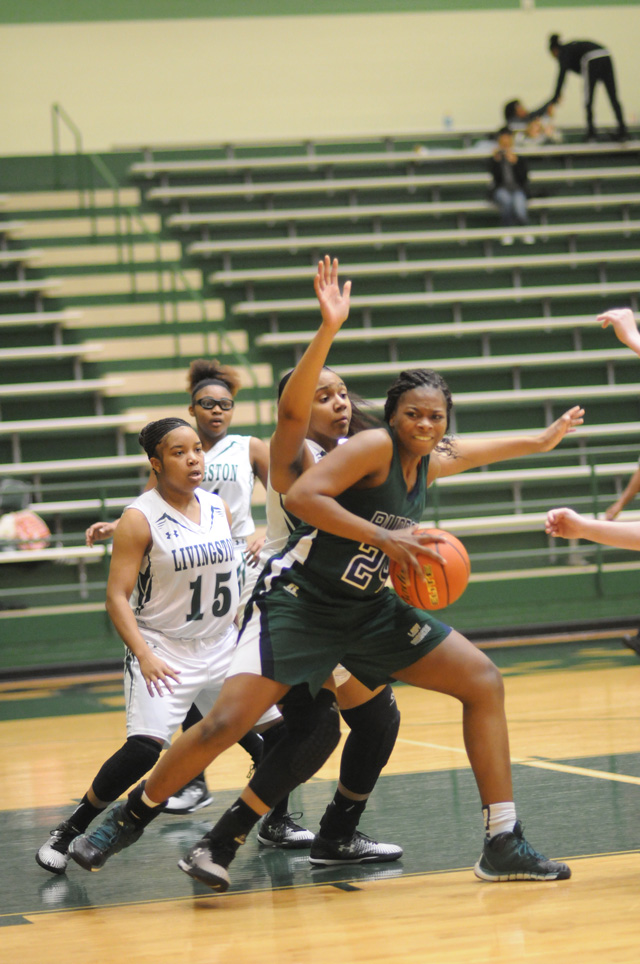 Briana Hutchinson had a tough battle guarding Deysta Wilbert (24) of Bryan Rudder. The Lady Ranger post led her team with 20 points in a 64-52 win over the Lady Lions.