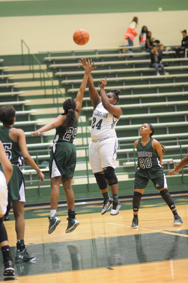 Shykia Phillips (24) of Livingston shoots a jumper in the paint for the Lady Lions during District 18-5A action against the Bryan Rudder Lady Rangers.