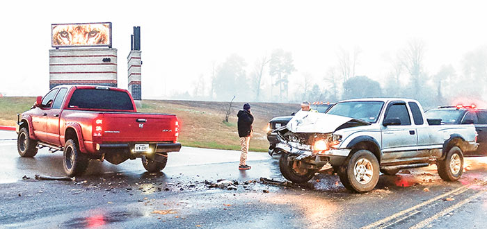 EARLY MORNING CRASH — No injuries were listed following a two-vehicle collision in front of the Livingston High School campus early Tuesday. The mishap occurred about 7 a.m. on FM 350 when a southbound grey Toyota Tacoma and a red Dodge Ram pickup collided as the pickup was attempting to turn left onto the school's entrance road. (Albert Trevino | Enterprise)