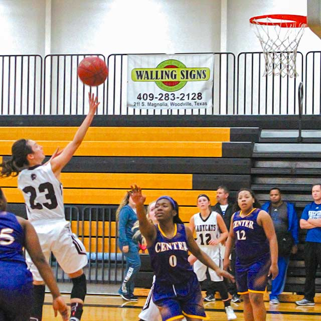 Brianna Cougot of Onalaska throws up a floater over the defense to help the Lady Wildcats slowly inch their way back into the game during the third period against the Center Roughriders. (Albert Trevino Photo)